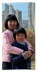 Two Chinese Teen Sisters Hug  And Embrace Shanghai China Beach Towel