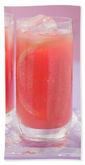 Two Glasses Of Pink Grapefruit Juice With Ice Cubes Beach Towel