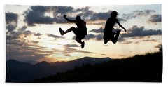 Two Men Jumping At Sunset In Idaho Beach Towel