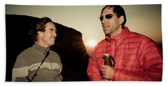 Two Men Share Stories As The Sun Sets Beach Towel
