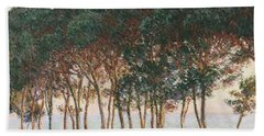 Under The Pines. Evening Beach Towel by Claude Monet