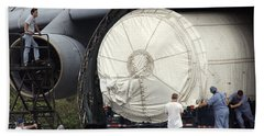 Beach Sheet featuring the photograph Unloading A Titan Ivb Rocket by Science Source
