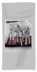 Various Forks On A Wooden Board Beach Towel