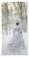 Victorian Woman Running Through A Winter Woodland With Fallen Sn Beach Towel