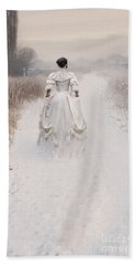 Victorian Woman Walking Through A Winter Meadow Beach Towel