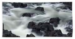 Water Over Rocks Beach Towel