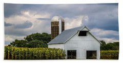 White Barn And Silo With Storm Clouds Beach Towel