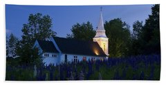 White Church At Dusk In A Field Of Lupines Beach Towel