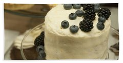 White Frosted Cake With Berries Beach Towel