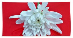 White Flower On Bright Red Background Beach Sheet