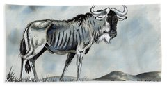 Wildebeest Beach Towel by Anthony Mwangi