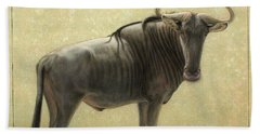 Wildebeest Beach Towel by James W Johnson