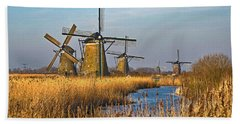 Windmills And Reeds Near Kinderdijk Beach Towel