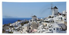 Windmills And White Houses In Oia Beach Towel