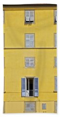 Windows Of Florence Against A Faded Yellow Plaster Wall Beach Towel