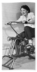 Woman On Exercycle Beach Towel