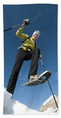 Woman Snowshoeing Below Mountain, San Beach Towel