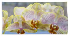 Yellow And Pink Orchids Beach Towel by Tine Nordbred
