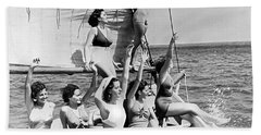 Young Women On A Sailboat. Beach Towel