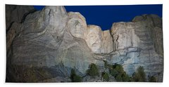 Mount Rushmore Nightfall Beach Towel by Steve Gadomski