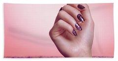 Woman Hand With Purple Nail Polish Beach Towel