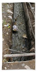 Beach Towel featuring the photograph A Dirty Drain With Filth All Around It Representing A Health Risk by Ashish Agarwal