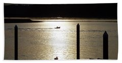 A Lone Boat At Sunset Beach Towel