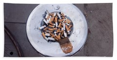 Beach Towel featuring the photograph A Lot Of Cigarettes Stubbed Out At A Garbage Bin by Ashish Agarwal