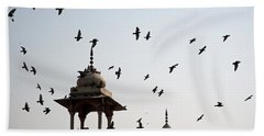 Beach Towel featuring the photograph A Whole Flock Of Pigeons On The Top Of The Ramparts Of The Red Fort In New Delhi by Ashish Agarwal