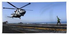 Airman Directs An Eh-101 Merlin Beach Towel