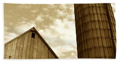 Barn And Silo In Sepia Beach Towel by JD Grimes