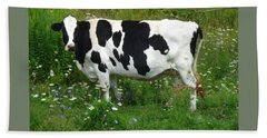 Cow In The Flowers Beach Towel by Patricia Overmoyer