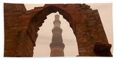 Cross Section Of The Qutub Minar Framed Within An Archway In Foggy Weather Beach Towel