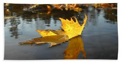 Fallen Maple Leaf Reflection Beach Towel by Kent Lorentzen