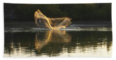 Fisherman Throwing His Net Beach Sheet by Anne Mott