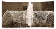 Fountain In Town Beach Towel
