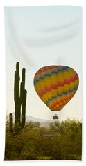 Hot Air Balloon In The Arizona Desert With Giant Saguaro Cactus Beach Towel