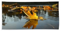 Maple Leaf Floating In River Beach Towel by Kent Lorentzen