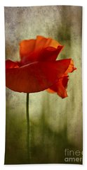 Beach Towel featuring the photograph Moody Poppy. by Clare Bambers - Bambers Images