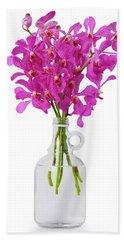 Purple Orchid In Bottle Beach Towel by Atiketta Sangasaeng