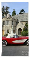 Red Corvette Outside The Playboy Mansion Beach Towel