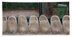 Rows Of Wooden Shoes Beach Towel by Carol Ailles