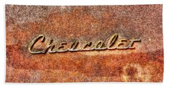 Rusted Antique Chevrolet Logo Beach Towel by Dan Stone