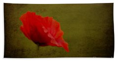 Beach Towel featuring the photograph Solitary Poppy. by Clare Bambers