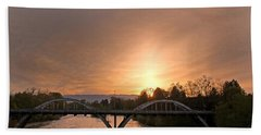 Sunburst Sunset Over Caveman Bridge Beach Towel by Mick Anderson