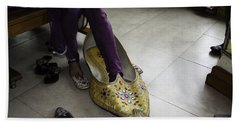 Beach Towel featuring the photograph Trying On A Very Large Decorated Shoe by Ashish Agarwal