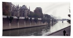 Walking The Dog Along The Seine Beach Towel by Tom Wurl