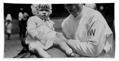 Beach Towel featuring the photograph Walter Johnson Holding A Baby - C 1924 by International  Images