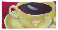 Yellow Cup On Red Beach Sheet by Patricia Cleasby