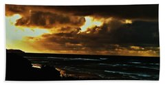 A Stormy Sunrise Beach Towel